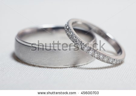 stock-photo-pair-of-silver-wedding-rings-on-white-linen-focus-on-diamonds-45600703